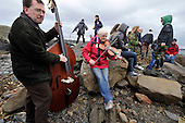 a band joined in complete with fiddle and double bass - at the World Stone Skimming Championships which attracted over 300 entries from all round the world - Easdale is reached by a small open ferry-boat from the Isle of Seil - south of Oban - picture by Donald MacLeod - 25.9.11 - clanmacleod@btinternet.com 07702 319 738 donald-macleod.com