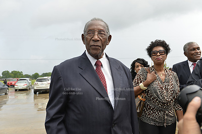 "5/30/15 Indianola,Civil rights icon and BB Kings good friend Charles Evers arrives for the funeral in Indianola Mississippi. Fans to see B. B Kings final home coming funeral procession outside the BB King Museum. A family member reaches out to touch the casket for one last time at the gravesite of Mr. King during the burial outside in the rain. The Thrill is gone, the casket holding the body of BB King arrives at the Bell Grove Missionary Baptist Church for his final homecoming. Blues legend B.B. King is is laid to rest in the shadow of the cotton gin at the B.B. King Museum and Interpretive Center. Mr King's final homecoming procession included a black horse WITH A saddle flanked with two of BB's famous ""Lucielle"" guitars signed by Mr. King. Fans lined the streets to watch the procession and pay their respect to the King of the Blues. Photo ©Suzi Altman"