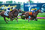 ELMONT, NY - MAY 12: Hi Happy,#7, ridden by jockey Luis Saez, wins the Man O' War Stakes  at Belmont Park on May 12, 2018 in Elmont, New York. (Photo by Dan Heary/Eclipse Sportswire/Getty Images)