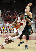 NWA Media/ J.T. Wampler -Arkansas' Manuale Watkins drive to the lane against a Utah Valley defender Saturday Jan. 3, 2015 at Bud Walton Arena in Fayetteville. The Hogs won 79-46.