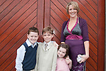 Luke Brady who made his First Communion at St. Mary's Church on Saturday 16th May, pictured with mum Sinéad, brother AAron and sister Faye