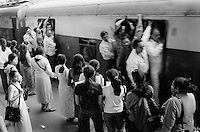 INDIA Maharashtra Mumbai Bombay, crowded city train at station / INDIEN Mumbai, ueberfuellter S-Bahn Zug am Bahnhof - copyright Joerg Boethling, Also as signed black&white fine print available.