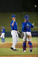 AZL Cubs relief pitcher Rollie Lacy (51) celebrates with catcher Kevin Zamudio (4) after the game against the AZL Mariners on August 4, 2017 at Sloan Park in Mesa, Arizona. AZL Cubs defeated the AZL Mariners 5-3. (Zachary Lucy/Four Seam Images)
