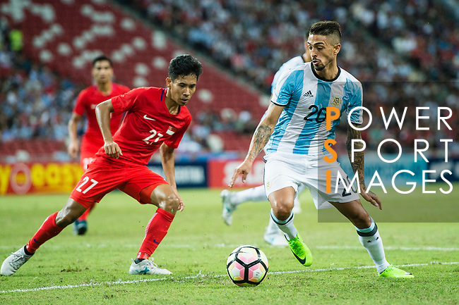 Manuel Lanzini of Argentina (R) fights for the ball with Nazrul Nazari of Singapore (L) in action during the International Test match between Argentina and Singapore at National Stadium on June 13, 2017 in Singapore. Photo by Marcio Rodrigo Machado / Power Sport Images