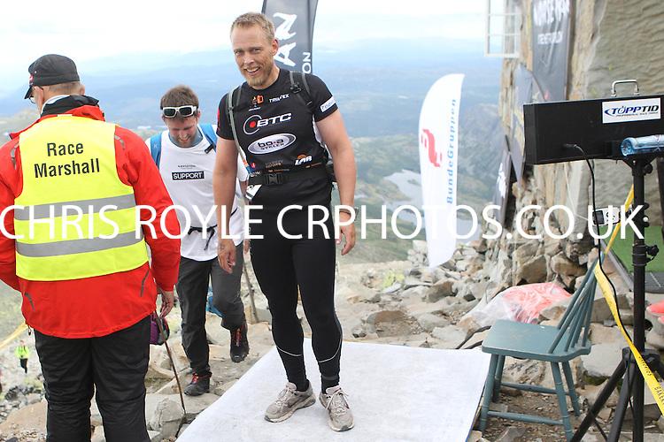Race number 106 - Tormod Thomsen - Sunday Norseman Xtreme Tri 2012 - Norway - photo by chris royle / boxingheaven@gmail.com
