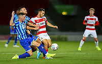 Blackpool's Ryan Edwards and Jordan Thompson battle with Doncaster Rovers' Jon Taylor<br /> <br /> Photographer Alex Dodd/CameraSport<br /> <br /> The EFL Sky Bet League One - Doncaster Rovers v Blackpool - Tuesday September 17th 2019 - Keepmoat Stadium - Doncaster<br /> <br /> World Copyright © 2019 CameraSport. All rights reserved. 43 Linden Ave. Countesthorpe. Leicester. England. LE8 5PG - Tel: +44 (0) 116 277 4147 - admin@camerasport.com - www.camerasport.com