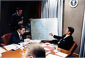 United States President Ronald Reagan asks a question during a Situation Room briefing by General Robert T. Herres, Vice Chairman of the Joint Chiefs of Staff, on the condition of the U.S. missile frigate Stark at the White House in Washington, D.C. on Tuesday, May 19, 1987.  U.S. Secretary of Defense Caspar Weinberger looks on..Mandatory Credit: Pete Souza - White House via CNP