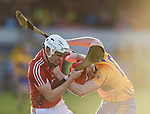 David Griffin of Cork and Niall Deasy of Clare get tangled off the ball during their Munster Hurling League game at Cusack Park. Photograph by John Kelly.