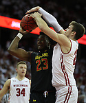 Feb 1, 2019; Madison, WI, USA; Maryland Terrapins forward Bruno Fernando (23) attempts a basket as Wisconsin Badgers forward Ethan Happ (22) blocks during the first half at the Kohl Center. Mandatory Credit: Mary Langenfeld-USA TODAY Sports