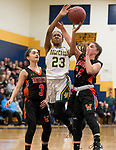 WATERBURY,  CT-021819JS23-  Holy Cross' Kayla Howard (23) lays up a shot between Watertown's Marissa Forino (3) and Chloe DeFeo (34) during their NVL semi-final game Monday at Kennedy High School in Waterbury. <br /> Jim Shannon Republican American