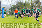 Iveragh Eagles charge the line led by Kevin O'Shea with ball in hand but denied glory by Dunmanway's Eamon Freenman.