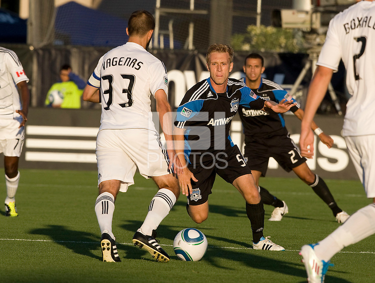 Brad Ring of Earthquakes tries to steal the ball away from Peter Vagenas of WhiteCaps during the game at Buck Shaw Stadium in Santa Clara, California on July 20th, 2011.  Earthquakes and WhiteCaps are tied 1-1 at halftime.