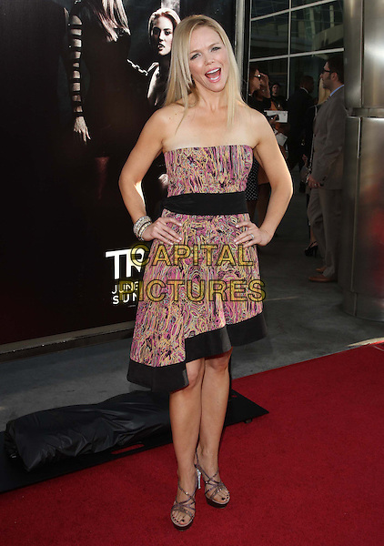 "Lauren Bowles.HBO's ""True Blood"" Season 4 Premiere  Held At The ArcLight Cinemas Cinerama Dome, Hollywood, California, USA..June 21st, 2011.full length dress hands on hips black trim waistband sandals strapless pink print mouth open.CAP/ADM/KB.©Kevan Brooks/AdMedia/Capital Pictures."
