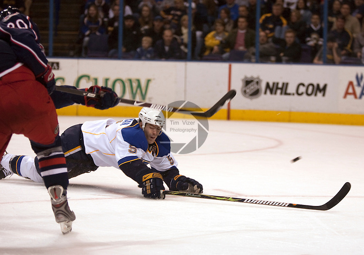 March 28 2009       Blues player Barret Jackman (5, right) dives to the ice as he attempts to block the shot on goal from Blue Jackets player Kristian Huselius (20, left) with his body in the second [period.  The St. Louis Blues hosted the  Columbus Blue Jackets March 28, 2009 at the Scottrade Center in downtown St. Louis, Missouri...            *******EDITORIAL USE ONLY*******