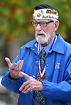 Veteran Charles Sehe tells stories to the crowd at a ceremony at the U.S.S. Nevada Memorial on the Capitol grounds in Carson City, Nev., on Wednesday, Oct. 14, 2015. Sehe served on the U.S.S. Nevada during World War II. <br /> Photo by Cathleen Allison