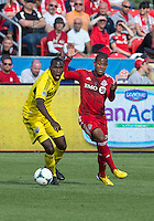 18 May 2013: Columbus Crew midfielder Tony Tchani #6 and Toronto FC defender Jeremy Hall #25 in action during an MLS game between the Columbus Crew and Toronto FC at BMO Field in Toronto, Ontario Canada..The Columbus Crew won 1-0...