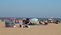 Sunbathers<br /> People head to the beach at the popular seaside resort of Skegness as England has it's hottest day of the year with temperatures well into the 30 degrees celcius. Kegness, England, UK on June 25, 2020.<br /> CAP/ROS<br /> ©ROS/Capital Pictures