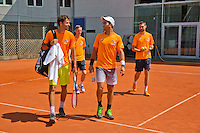 Austria, Kitzbuhel, Juli 15, 2015, Tennis, Davis Cup, Training Dutch team, Haase and Rojer entering the court followed by stringer Ralf Pieterman (M) and fysio Edwin Visser<br /> Photo: Tennisimages/Henk Koster