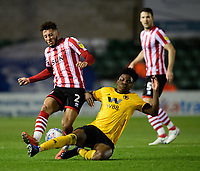 Lincoln City's Kellan Gordon vies for possession with Wolverhampton Wanderers U21's Niall Ennis<br /> <br /> Photographer Chris Vaughan/CameraSport<br /> <br /> The EFL Checkatrade Trophy Northern Group H - Lincoln City v Wolverhampton Wanderers U21 - Tuesday 6th November 2018 - Sincil Bank - Lincoln<br />  <br /> World Copyright © 2018 CameraSport. All rights reserved. 43 Linden Ave. Countesthorpe. Leicester. England. LE8 5PG - Tel: +44 (0) 116 277 4147 - admin@camerasport.com - www.camerasport.com