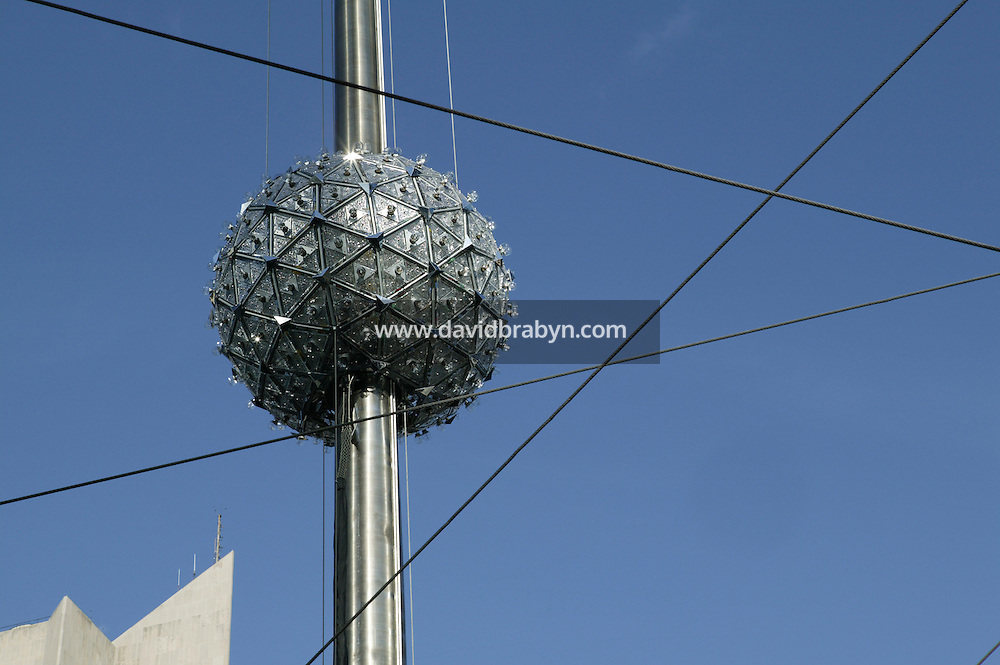 30 December 2005 - New York City, NY - The New Year's Eve Ball is sent up the 77-foot-tall flagpole atop the One Times Square building in the annual test run ahead of the New Year's Eve countdown, New York City, USA, 30 December 2005. Photo Credit: David Brabyn.