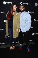 LOS ANGELES, CA - AUGUST 4: Urbana Lawrence, Philip Lawrence at the 4Moms launch of the world's first self-installing car seat at Petersen Automotive Museum in Los Angeles, California on August 4, 2016. Credit: David Edwards/MediaPunch