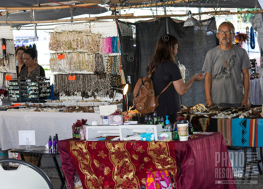 Jewelry and other sundry vendors at the Hilo Farmers Market on Mamo Street, Hilo, Big Island of Hawai'i.