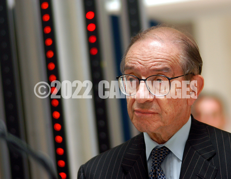 """PHILADELPHIA - JULY 2: Honorable Alan Greenspan, Chairman of the Board of Governors of the Federal Reserve System, listens as Philadelphia Federal Reserve Bank President Anthony Santomero, not shown, opens the new """"Money in Motion"""" exhibit at the Philadelphia Federal Reserve Bank July 2, 2003 in Philadelphia, Pennsylvania. """"Money in Motion is a free, fun, interactive exhibit about money, banking, and the Federal Reserve, which opens to the public July 3, 2003. (Photo by William Thomas Cain/Getty Images)"""