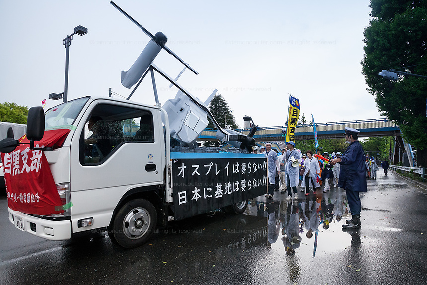 A float featuring a crashing Osprey aircraft in protest at their deployment in Japan with thousands of people who took part in the 88th May Day rally in Central Tokyo to mark International Workers` Day. Tokyo, Japan. Monday, May 1st 2017 The rally started at 9am in Yoyogi Park near Shibuya and the march began at 12:30 despite heavy rain and thunderstorms. The rally called for an end to overwork in Japan along with other labour issues and  protested traditional left wing subjects such as nuclear power and weapons, and Prime Minister Shinzo Abe's plans to reinterpret  Article 9 of the Japanese constitution, thus making the Japanese military Self Defence Force able to fight wars alongside its allies.