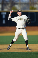 Wake Forest Demon Deacons third baseman Will Craig (22) makes a throw to first base between innings of the game against the Towson Tigers at Wake Forest Baseball Park on February 15, 2014 in Winston-Salem, North Carolina.  The Tigers defeated the Demon Deacons 5-4.  (Brian Westerholt/Four Seam Images)