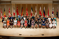Contestants pose for a group photo during the opening ceremony of the 11th USA International Harp Competition at Indiana University in Bloomington, Indiana on Wednesday, July 3, 2019. (Photo by James Brosher)