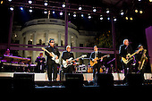 """Washington, DC - October 13, 2009 -- Chicano rock band Los Lobos performs during the """"In Performance at the White House: Fiesta Latina"""" concert, celebrating Hispanic musical heritage, on the South Lawn of the White House, October 13, 2009. .Mandatory Credit: Pete Souza - White House via CNP"""