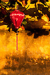 Ochre Wall Silk Lantern 03 - Red silk lantern on an ochre wall, late afternoon, Hoi An, Viet Nam.