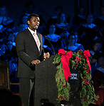 Michael Morrow, an acting student in The Theatre School, narrates this year's performance of Christmas at DePaul, held at the Saint Vincent de Paul Parish Church in Lincoln Park. Christmas at DePaul is the retelling of the birth of Christ in word and song. The event is offered as a gift to the community and guests are asked to donate either money or food items to support the St. Vincent de Paul Parish Food Pantry. Each year a student is selected from The Theatre School to narrate the sacred story as selections of classical holiday music celebrating the birth of Christ are performed by the DePaul Community Chorus and student musicians from the School of Music. (DePaul University/Jamie Moncrief)