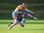 Niall Deasy of Clare in action against Ian Byrne of Wexford during the Jack Lynch Memorial game at Tulla. Photograph by John Kelly.