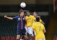 August 03, 2012 - Japan's Yuki Ogimi and Brazil's Formiga in action during during group F match between JPN and BRA at the Millennium Stadium. .