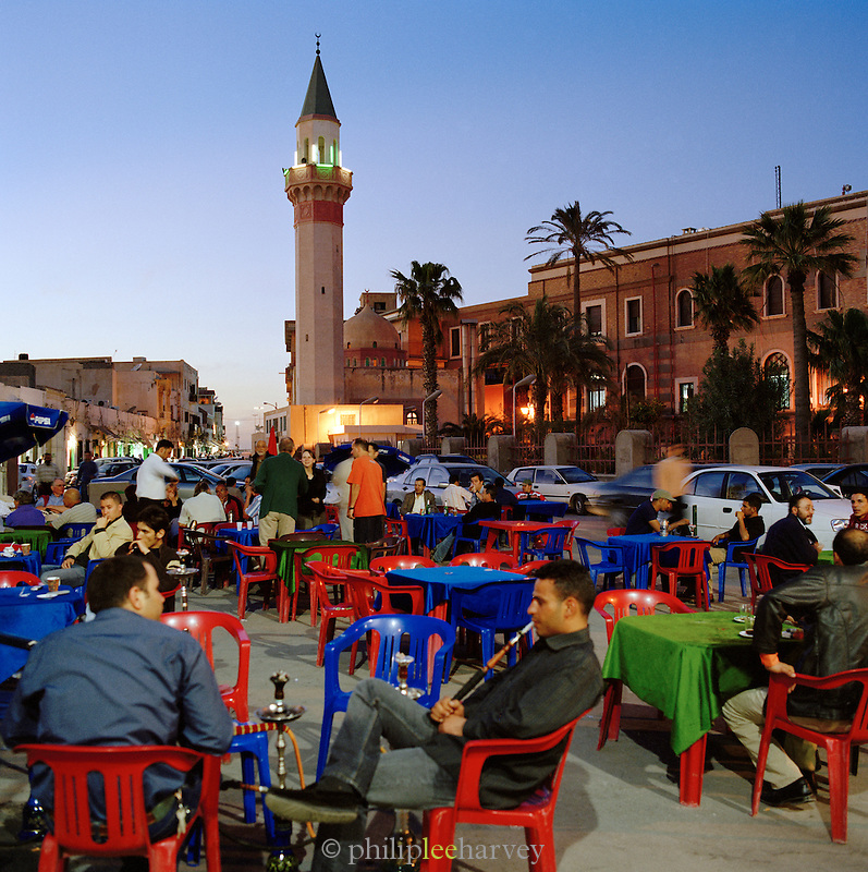 Locals and tourists mix at open air cafes, Tripoli, Libya