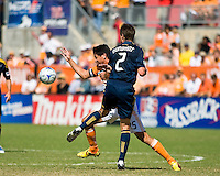 Los Angeles Galaxy defender Todd Dunivant (2) collides with Houston Dynamo forward Brian Ching (25). Houston Dynamo tied Los Angeles Galaxy 0-0 at Robertson Stadium in Houston, TX on October 18, 2009.