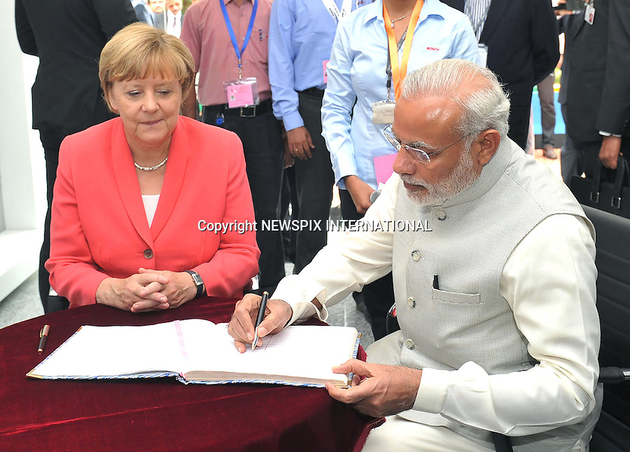 06.10.2015; Bangalore, India: GERMAN CHANCELLOR ANGELA MERKEL AND INDIAN PM MODI<br /> visit the Robert Bosch Engineering &amp; Innovation Centre in Bengaluru.<br /> Merkel is on a 3-day visit to India<br /> Mandatory Credit Photos: NEWSPIX INTERNATIONAL<br /> <br /> **ALL FEES PAYABLE TO: &quot;NEWSPIX INTERNATIONAL&quot;**<br /> <br /> PHOTO CREDIT MANDATORY!!: NEWSPIX INTERNATIONAL(Failure to credit will incur a surcharge of 100% of reproduction fees)<br /> <br /> IMMEDIATE CONFIRMATION OF USAGE REQUIRED:<br /> Newspix International, 31 Chinnery Hill, Bishop's Stortford, ENGLAND CM23 3PS<br /> Tel:+441279 324672  ; Fax: +441279656877<br /> Mobile:  0777568 1153<br /> e-mail: info@newspixinternational.co.uk