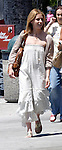 .July 30th 2010  Exclusive..Sarah michelle Gellar went shopping on Larchmont st in west Hollywood with a friend. Sarah was carrying a big ugly brown purse hand bag & wearing gold sandals that looked like something from the Roman Empire during the Gladiator days. Sarah was also wearing a long white sundress. Take a look at that crazy face the  lady is making behind her.  ...AbilityFilms@yahoo.com.805-427-3519.www.AbilityFilms.com.