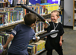 Jared Ashon, 9, and Connor Mathers, 4, practice their Jedi skills during the Star Wars Day celebration at the Carson City Library in Carson City, Nev. on Wednesday, May 4, 2016.<br /> Photo by Cathleen Allison