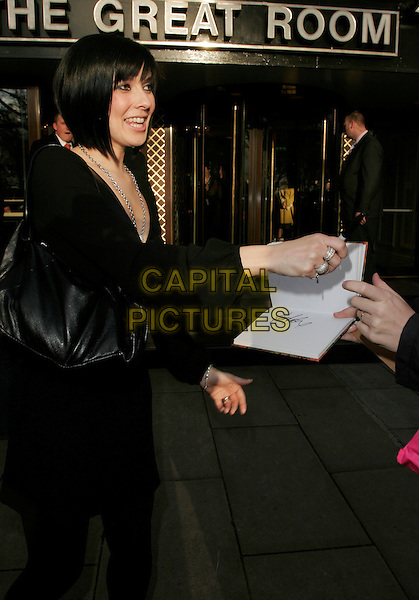 KYM RYDER.Leaving the TRIC Awards (The television and Radio Industries Club) at grosvenor House, Park Lane,.London, England, March 6th 2007..full 3/4 length kim marsh black fringe signing autograph.CAP/AH.©Adam Houghton/Capital Pictures.