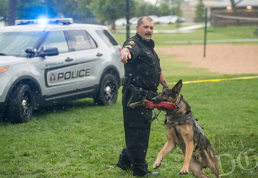NWA Democrat-Gazette/BEN GOFF @NWABENGOFF<br /> Cpl. Ashley Booth and K9 partner Oliver give a presentation Tuesday, Aug. 7, 2018, during the Springdale Police Department's National Night Out event at Murphy Park. The annual campaign aims to build police-community relationships and promote safer neighborhoods with games and activities for children and ways for families to interact with police in a casual setting.