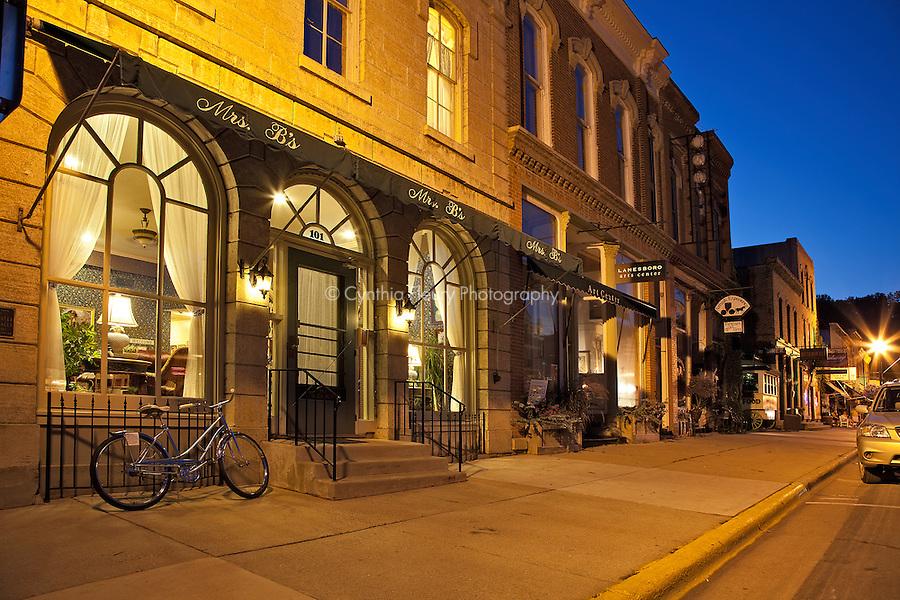 Main street Lanesboro, MN at night showing Mrs. B's Bed and Breakfast and Lanesboro Art Center.