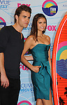UNIVERSAL CITY, CA - JULY 22: Paul Wesley, Nina Dobrev pose in the press room at the 2012 Teen Choice Awards at Gibson Amphitheatre on July 22, 2012 in Universal City, California.