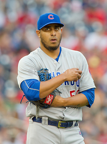 Chicago Cubs relief pitcher Hector Rondon (56) pauses between pitches as he works in the ninth inning against the Washington Nationals at Nationals Park in Washington, D.C. on Wednesday, June 15, 2016.  The Nationals won the game 5 - 4 in 12 innings.<br /> Credit: Ron Sachs / CNP/MediaPunch