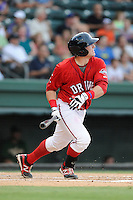 Catcher Jordan Procyshen (29) of the Greenville Drive bats in a game against the Savannah Sand Gnats on Friday, August 22, 2014, at Fluor Field at the West End in Greenville, South Carolina. Greenville won, 6-5. (Tom Priddy/Four Seam Images)
