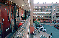 Paramedic ambulance crew with patient. They have put him into a wheelchair to take him through the block of flats down to the ambulance...© SHOUT. THIS PICTURE MUST ONLY BE USED TO ILLUSTRATE THE EMERGENCY SERVICES IN A POSITIVE MANNER. CONTACT JOHN CALLAN. Exact date unknown.john@shoutpictures.com.www.shoutpictures.com....