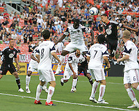 Andy Najar #14 of D.C. United leaps above Jean Alexandre #12 of Real Salt Lake to connect with a header during an MLS match at RFK Stadium, on June 5 2010 in Washington DC. The game ended in a 0-0 tie.