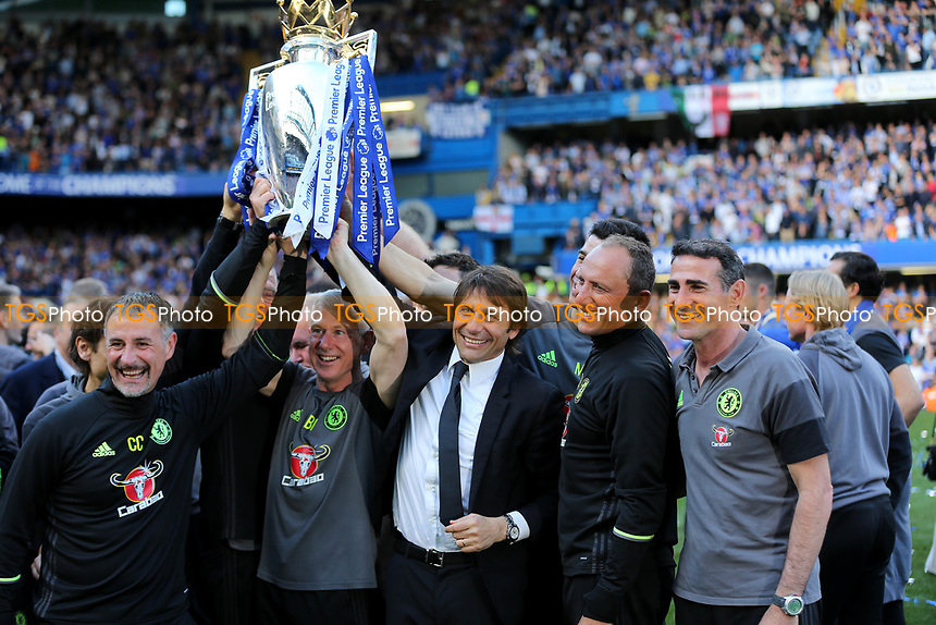 Chelsea Manager, Antonio Conte, celebrates winning the Premier League Trophy with some of his coaching staff   during Chelsea vs Sunderland AFC, Premier League Football at Stamford Bridge on 21st May 2017