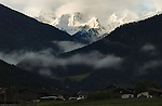 Snow capped mountain and pasture overlooking farm property, Imst district, Tyrol,Tirol, Austria.